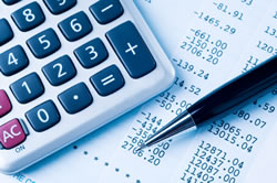 Calculator and accounting paperwork