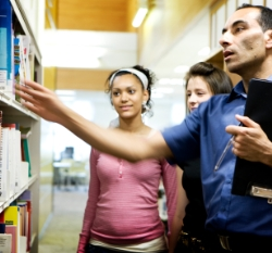A librarian helps students with research