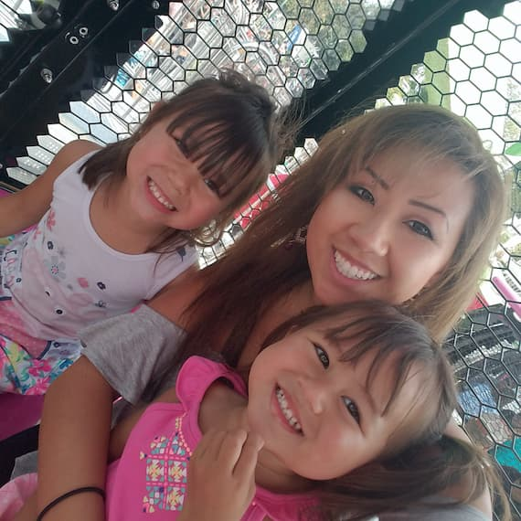 Mainhia Ly with her two daughters